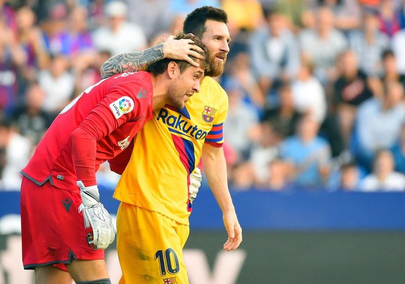 Aitor Fernandez (z lewej) i Lionel Messi /AFP