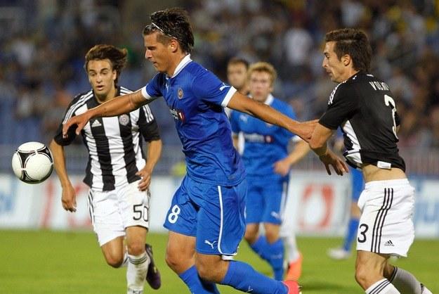 Aleksandar Prijović (w niebieskim stroju) trafił do Legii /AFP