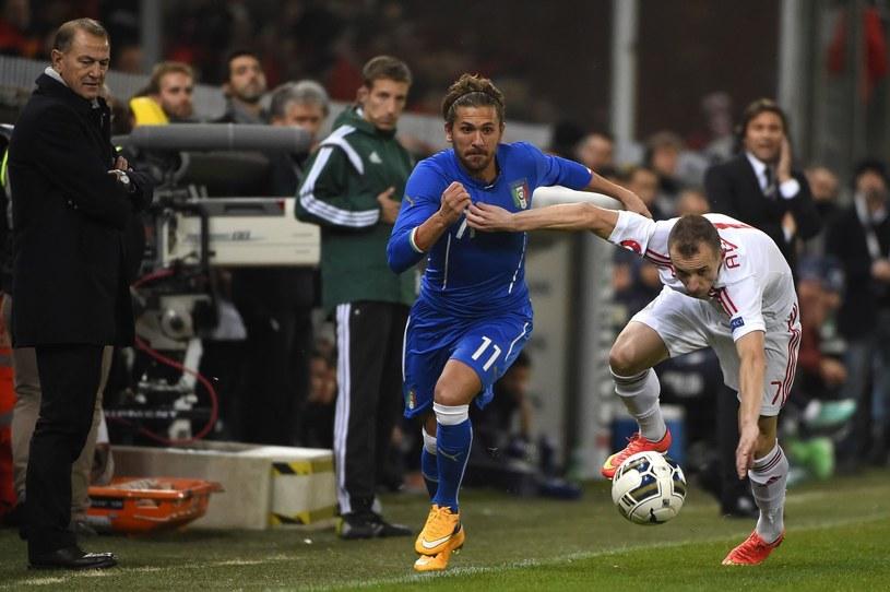 Alessio Cerci (w niebieskim stroju) w koszulce włoskiej kadry /AFP