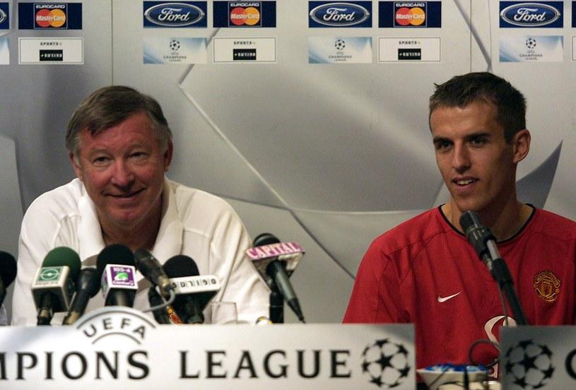 Alex Ferguson i Phil Neville w 2002 roku /AFP