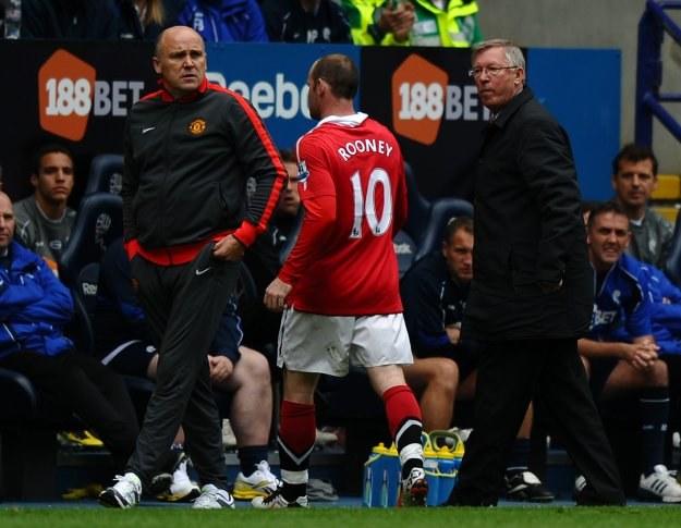 Alex Ferguson (z prawej) i Wayne Rooney /AFP