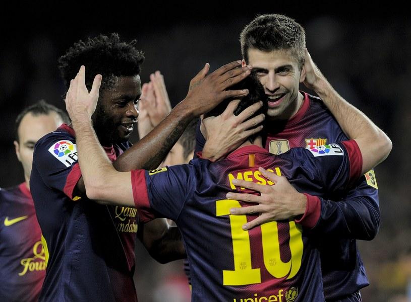 Alex Song, Lionel Messi i Gerard Pique /AFP