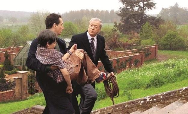 Alfred  (Michael Caine) zna Bruce'a od dziecka. /East News Poland SP.Z O.O.