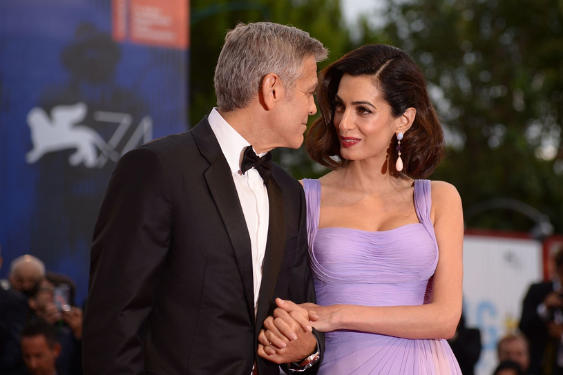 Amal i George Clooney tworzą bardzo szczęśliwą parę /AFP
