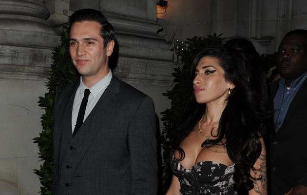 Amy Winehouse i Reg Traviss   /Splashnews