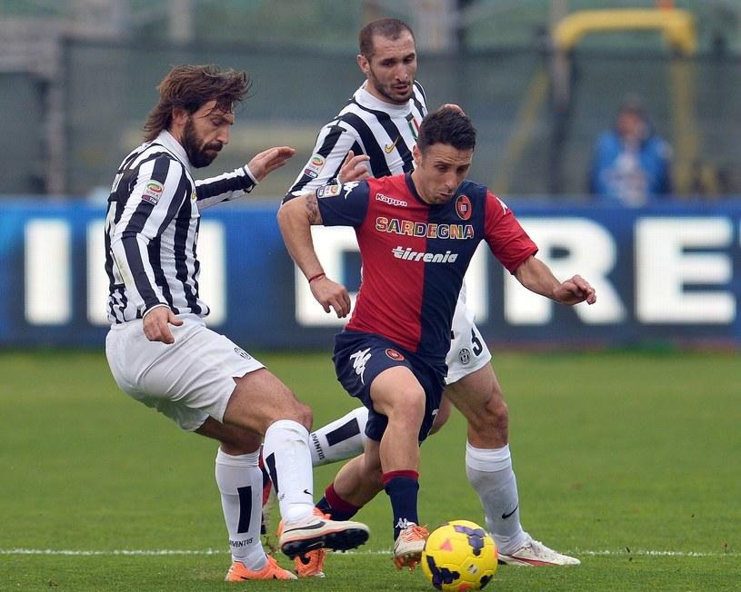 Andrea Cossu w meczu z Juventusem w 2014 roku /GABRIEL BOUYS /AFP