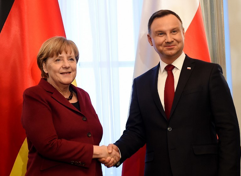 Angela Merkel i Andrzej Duda /AFP