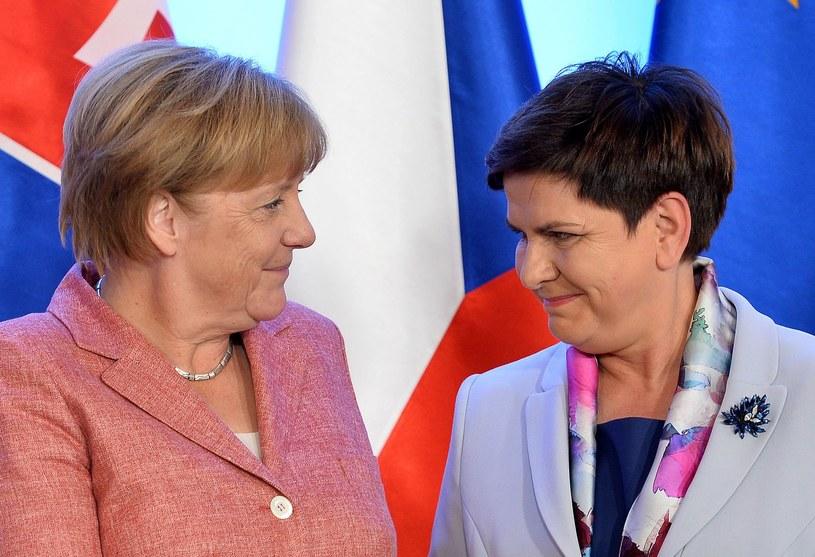 Angela Merkel i Beata Szydło i jej broszka /AFP