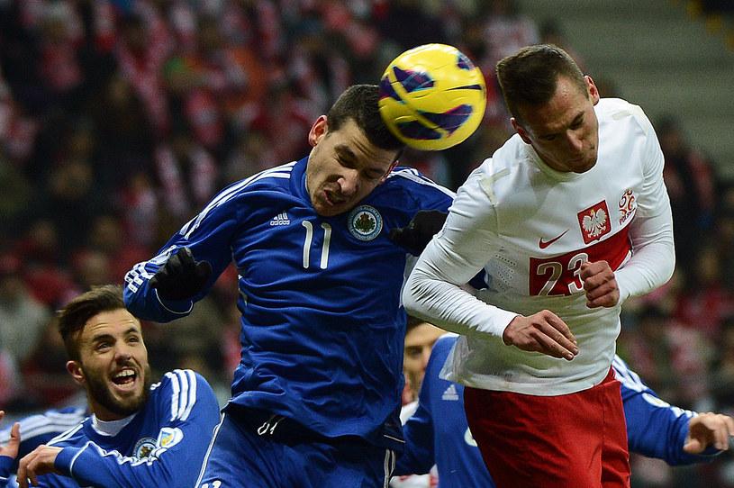 Arkadiusz Milik (z prawej) podczas meczu reprezentacji Polski /AFP