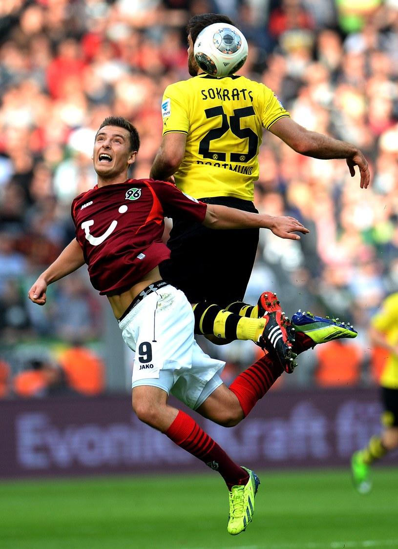 Artur Sobiech i Sokratis z Borussii Dortmund /AFP