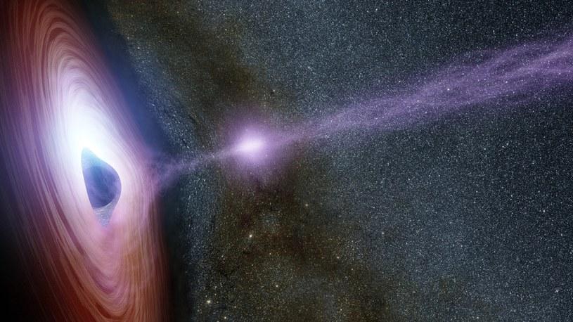 Artystyczna wizja wiązki promieniowania rentgenowskiego emitowanego przez czarną dziurę /materiały prasowe