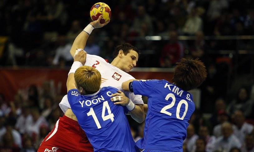 Bartłomiej Jaszka podczas meczu z Koreą /AFP