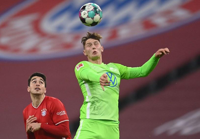 Bartosz Białek (z prawej) w meczu z Bayernem Monachium /AFP/POOL CHRISTOF STACHE/ /AFP