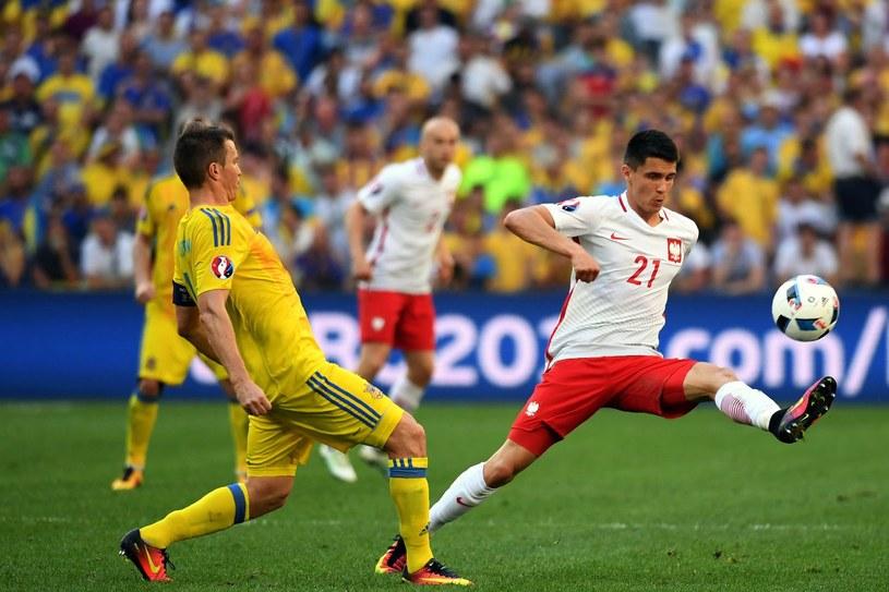 Bartosz Kapustka (z prawej) /AFP