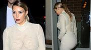 Biust i pupa Kim Kardashian w siatkowej kreacji