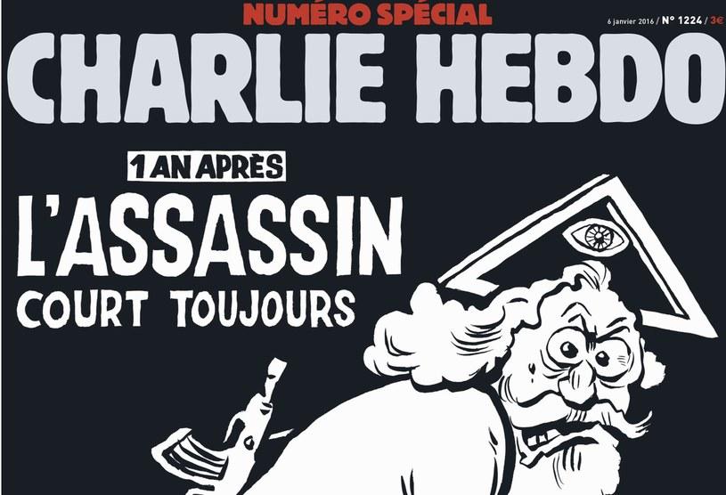 """Bóg z kałasznikowem na pierwszej stronie rocznicowego """"Charlie Hebdo"""" /AFP"""