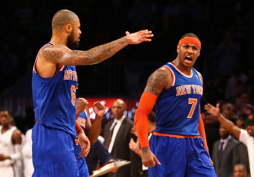 Carmelo Anthony (pierwszy z prawej) poprowadził Knicks do zwycięstwa nad Nets /AFP
