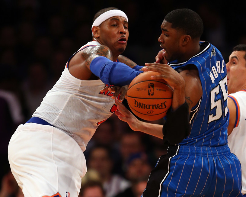 Carmelo Anthony (z lewej) w meczu z Orlando Magic /AFP