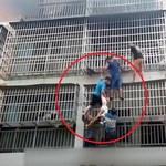 """Chiny: Sześciu mężczyzn utworzyło """"żywą drabinę"""", ratując z pożaru dwie dziewczynki"""