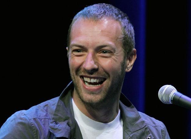 Chris Martin (Coldplay) najwyraźniej cieszy się na wizytę w Polsce - fot. Justin Sullivan /Getty Images/Flash Press Media