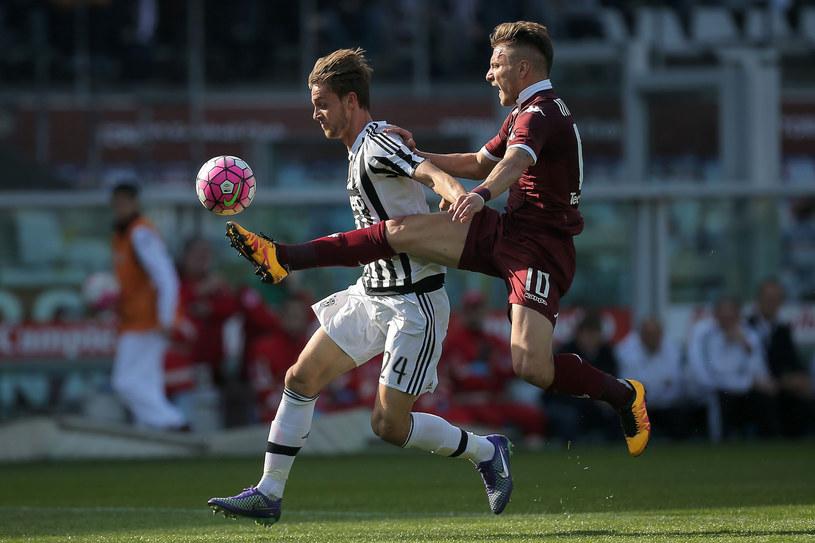 Ciro Immobile w walce  o piłkę z zawodnikiem Juventusu - Daniele Ruganim /MARCO BERTORELLO /East News