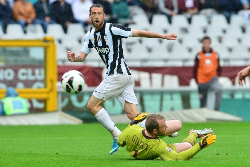 Claudio Marchisio strzela gola w meczu z Torino /AFP
