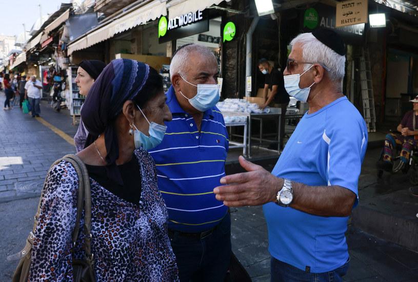 COVID-19 jest z nami i z nami zostanie - uważa izraelski ekspert /AFP
