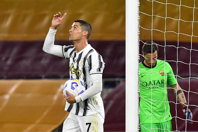 Cristiano Ronaldo celebruje bramkę w starciu z AS Roma / TIZIANA FABI /AFP