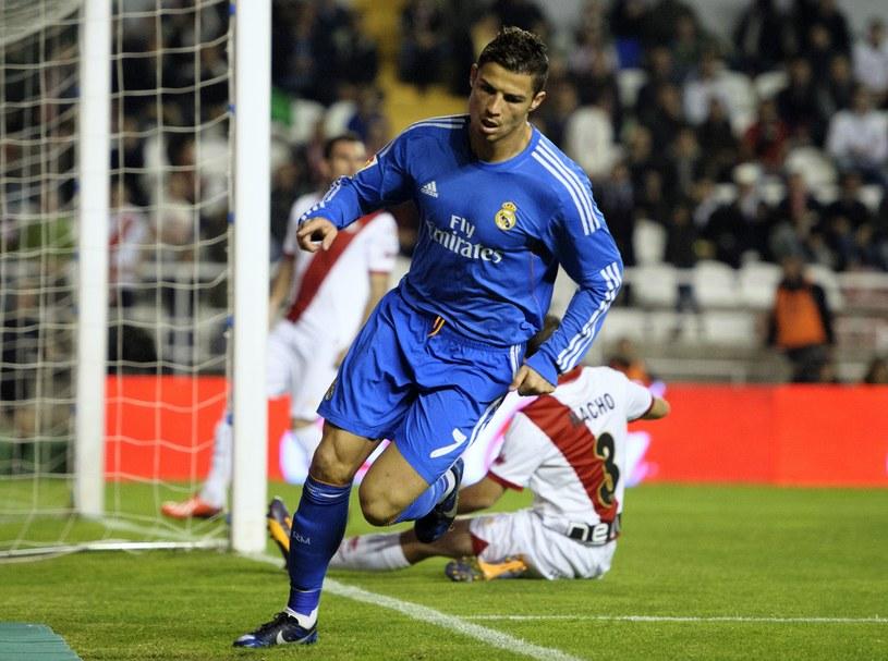Cristiano Ronaldo cieszy się z gola dla Realu w meczu z Rayo Vallecano /AFP