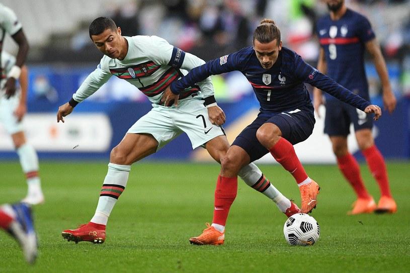 Cristiano Ronaldo i Antoine Griezmann podczas meczu Portugalia - Francja. Powołanie Superligi może doprowadzić do wydania przez UEFA zakazu ich gry w reprezentacjach narodowych /ABACA/NEWSPIX.PL /Newspix