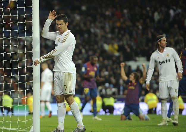 Cristiano Ronaldo przeżywa porażkę w poprzednich Gran Derbi /AFP