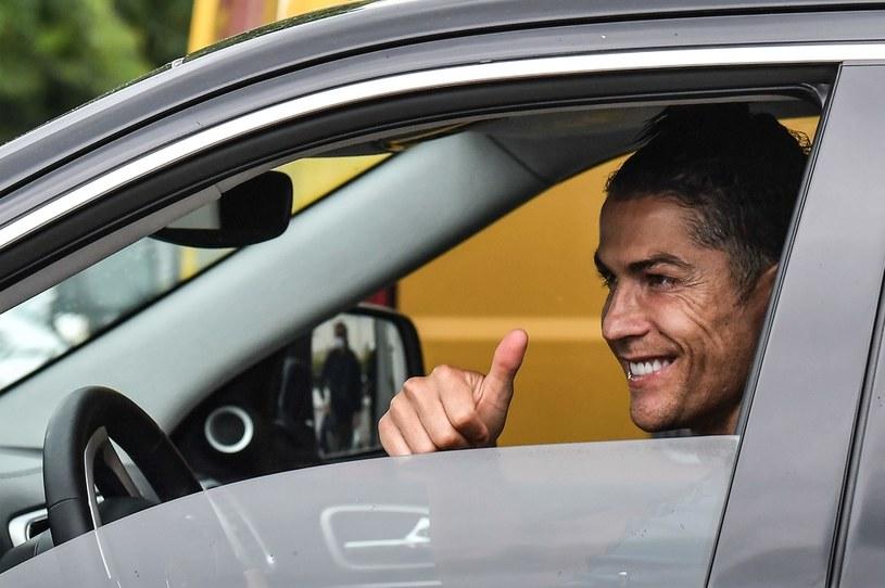 Cristiano Ronaldo w drodze do centrum treningowego Juventusu /AFP