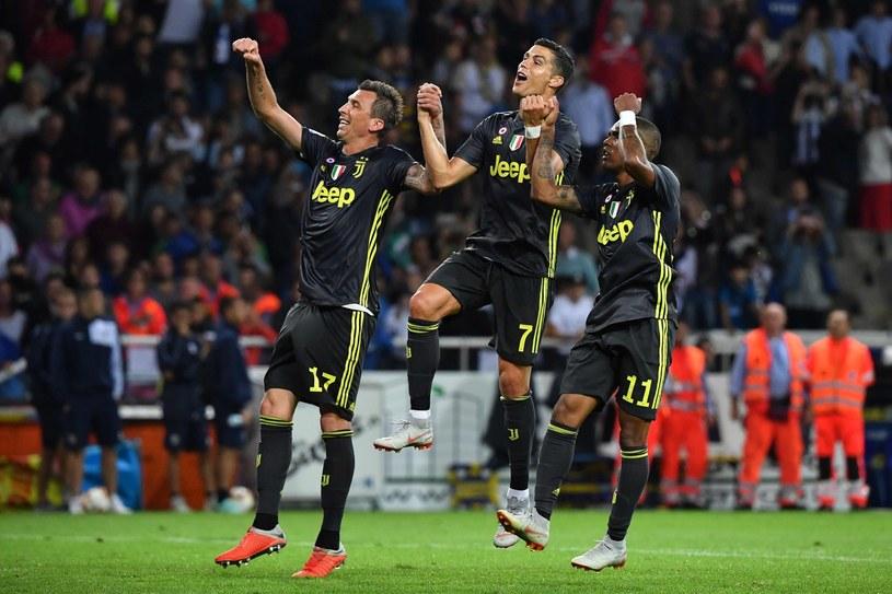 Cristiano Ronaldo (w środku) /AFP