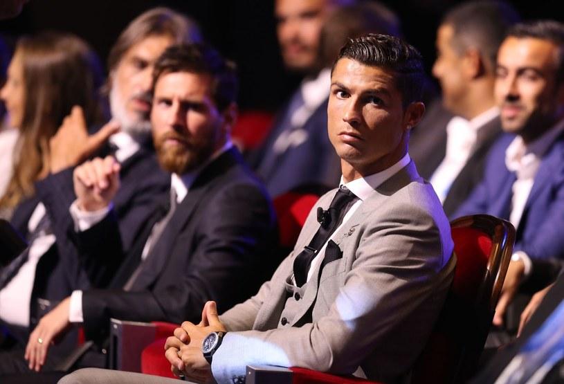 Cristiano Ronaldo, w tle Lionel Messi /AFP