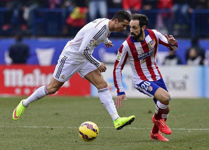 Cristiano Ronaldo (z lewej) w meczu z Atletico /AFP