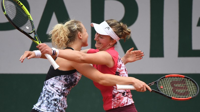 Czech Republic's Katerina Siniaková (L) and Barbora Krejcikova celebrate after victory over Japan's Eri Hozumi and Makoto Ninomiya during their women's doubles final match on day fifteen of The Roland Garros 2018 French Open /Getty Images