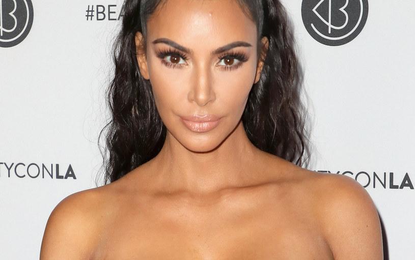 Czyżby opieka nad dziećmi przerosła Kim Kardashian? /David Livingston /Getty Images