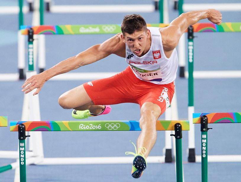 Damian Czykier poczas biegu półfinałowego /Adam Warżawa /PAP
