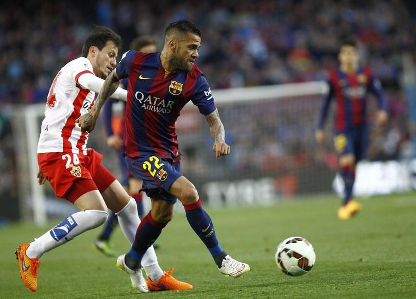 Dani Alves reprezentuje Barcelonę od 2008 roku /AFP