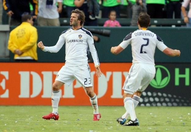 David Beckham (z lewej) /AFP