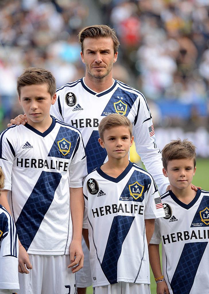 David Beckham z synami (w środku Romeo Beckham) /Harry How /Getty Images