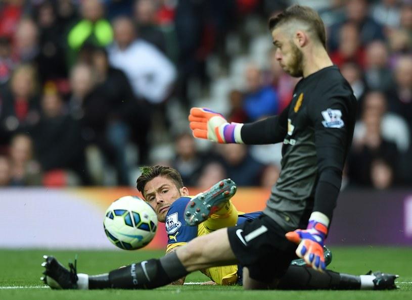 David de Gea z Man Utd broni strzał Oliviera Giroud z Arsenalu /AFP