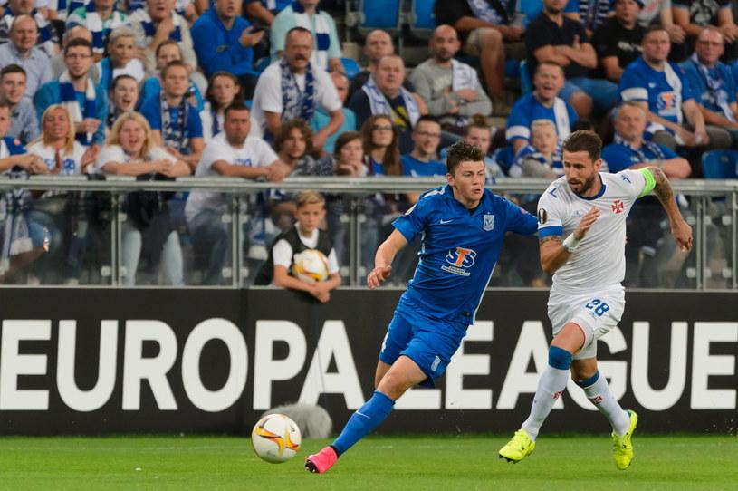 Dawid Kownacki (niebieski strój) w akcji w meczu z Belenenses /PAP