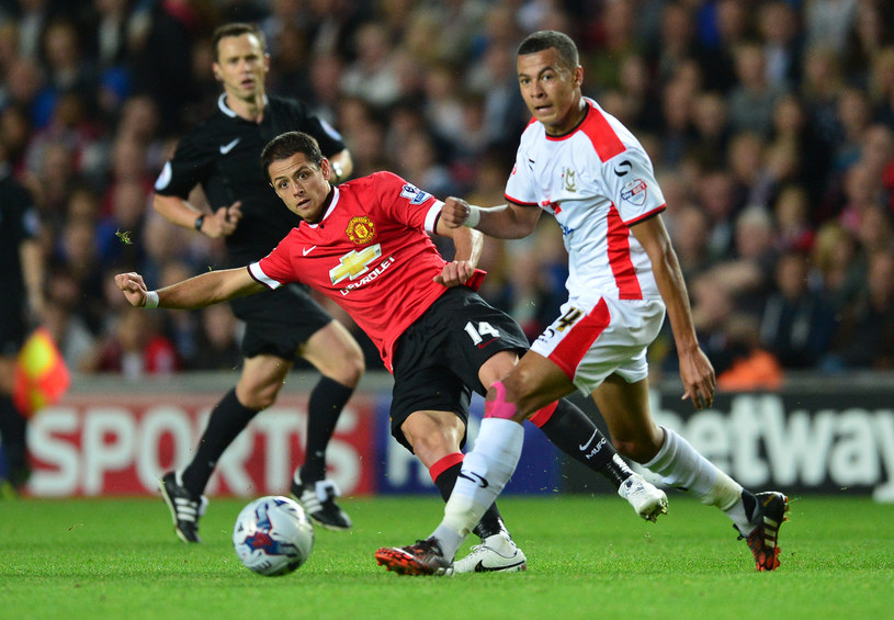 Dele Alli (z prawej) w meczu Pucharu Ligi z Manchesterem United /Carl Court /AFP