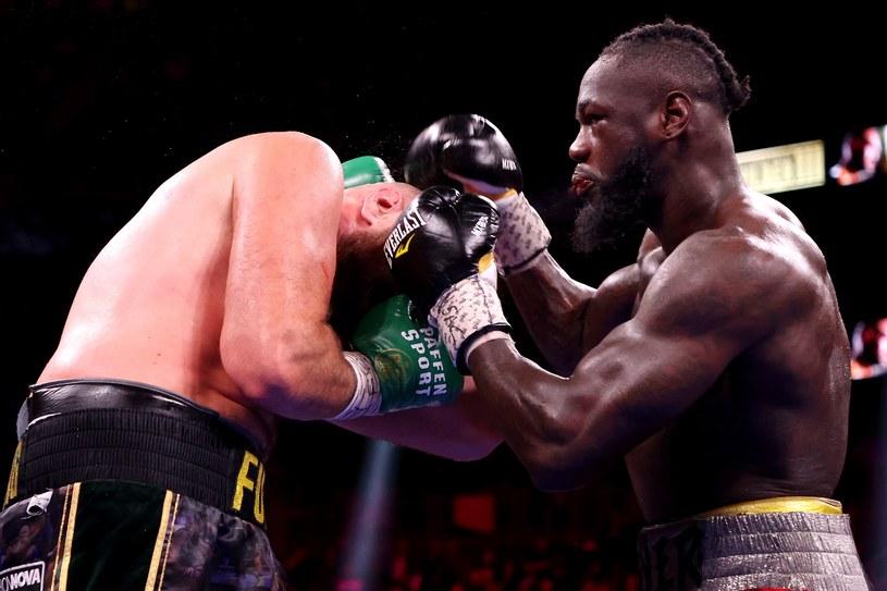 Deontay Wilder w walce z Tysonem Furym /AFP