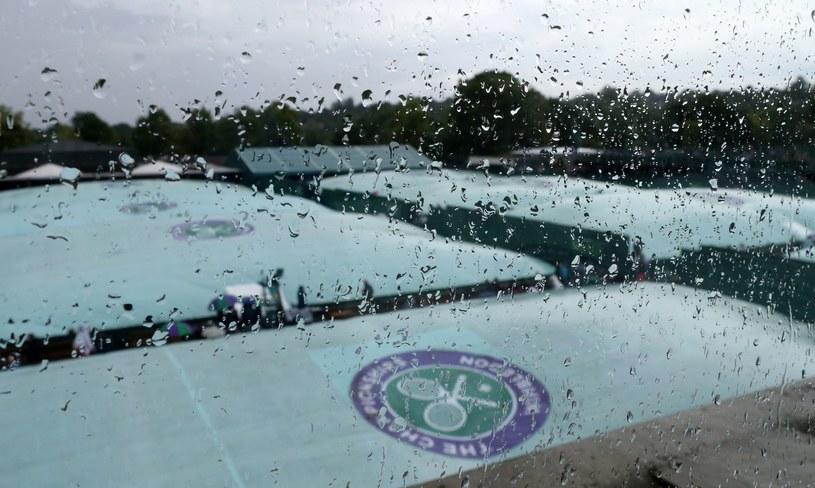 Deszcz na Wimbledonie to tradycja! /AFP