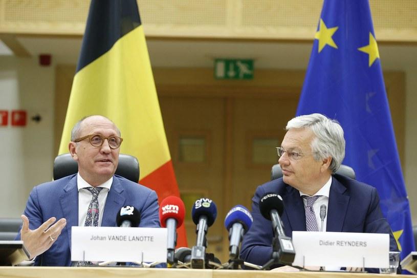 Didier Reynders (z prawej) /AFP