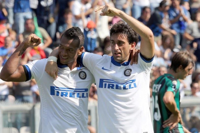 Diego Milito (z prawej) i Fredy Guarin /AFP