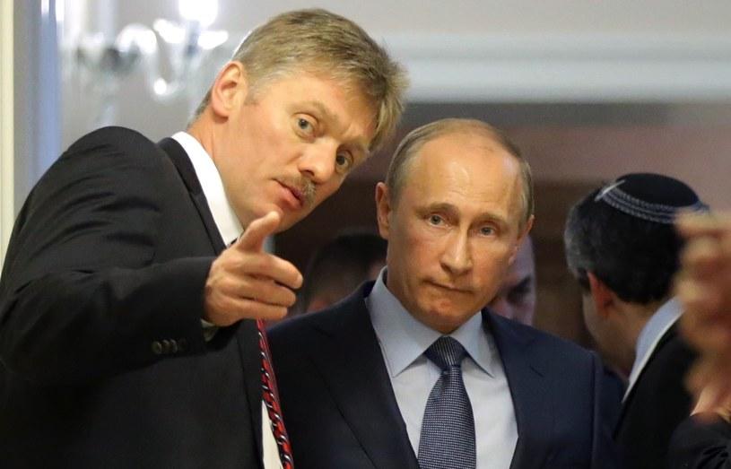 Dmitrij Pieskow i Władimir Putin /AFP