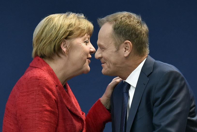 Donald Tusk i Angela Merkel /GERARD JULIEN /AFP